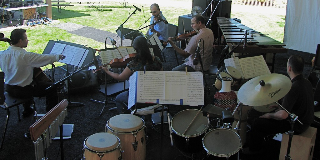 Cotto and the Dali String quartet rehearsing Puente Trans-Arabico at the Cottonwood Festival.